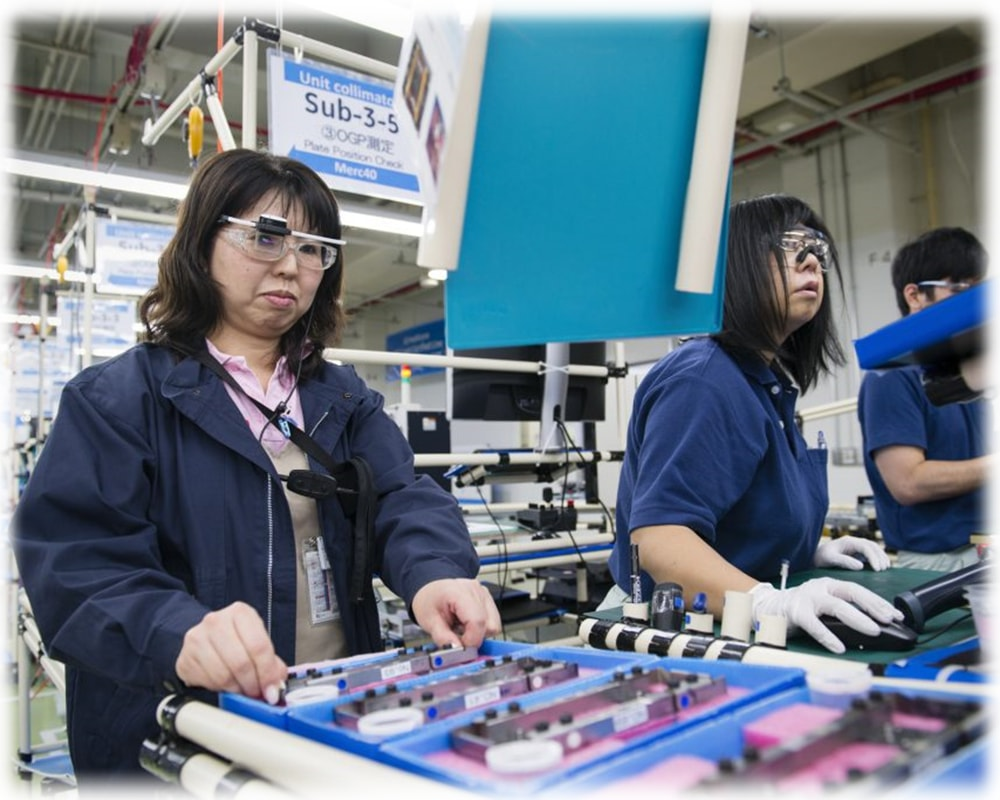 Workers at a factory using smart glasses to do work