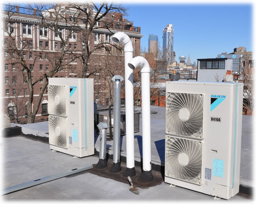 Air conditioning compressor fans on top of a building